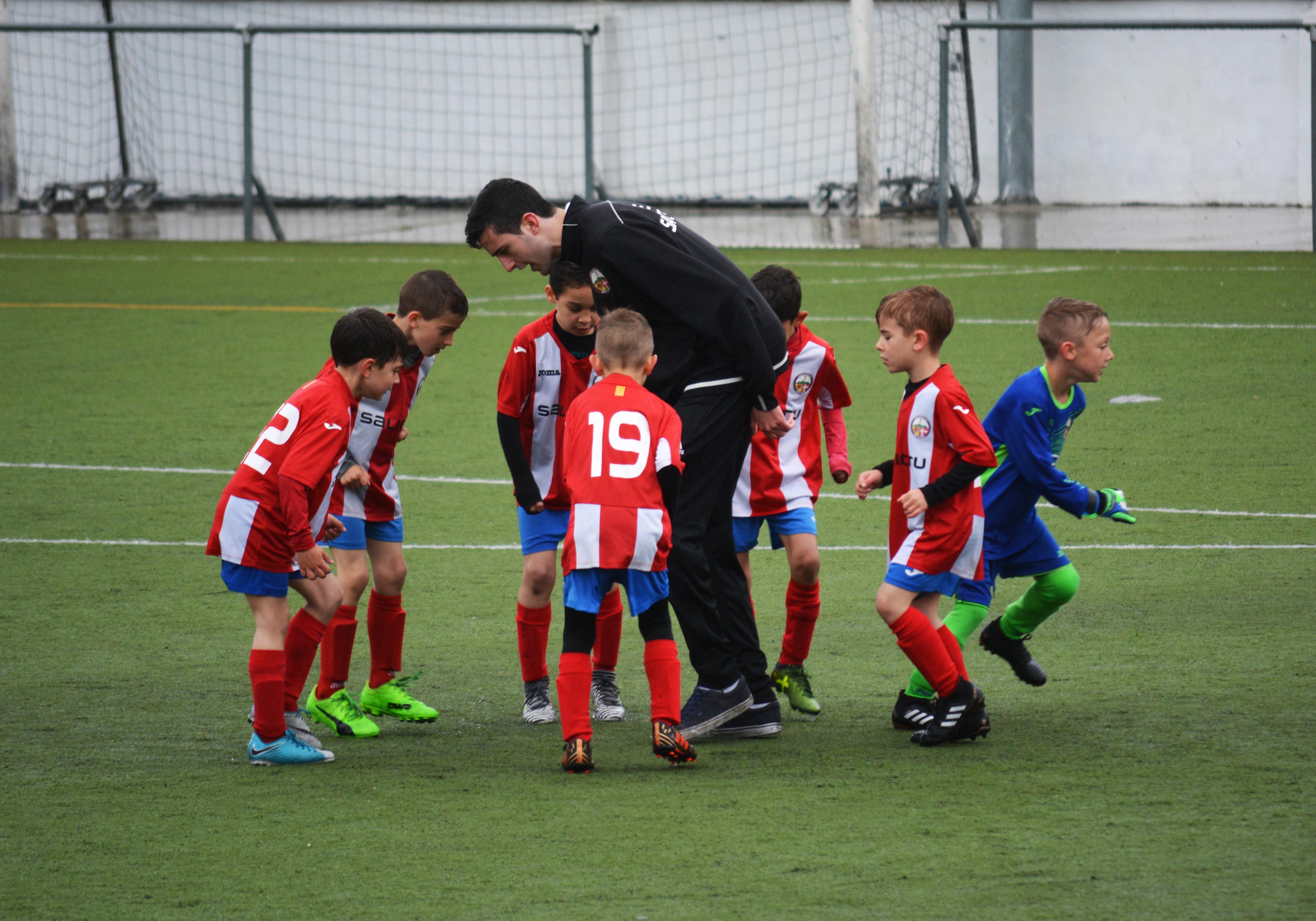 Young soccer team with their coach
