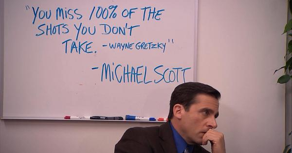 Michael Scott from The Office sat next to a Wayne Gretzky quote written on a white board