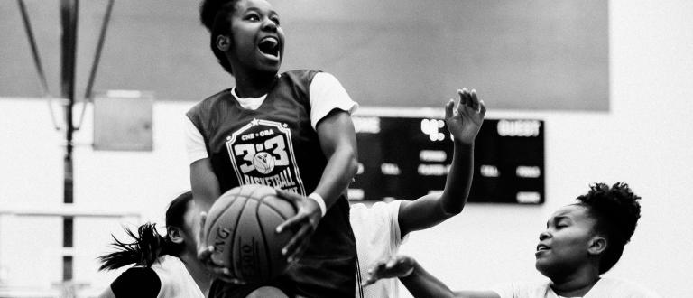 Young girls playing basketball