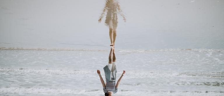 Woman walking on water and her reflection