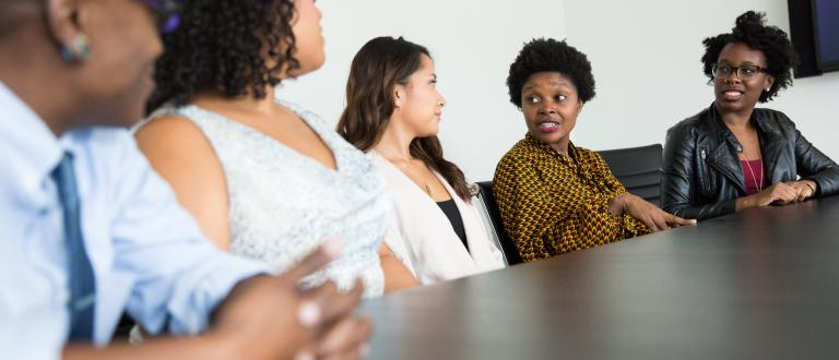 Women of colour in a meeting