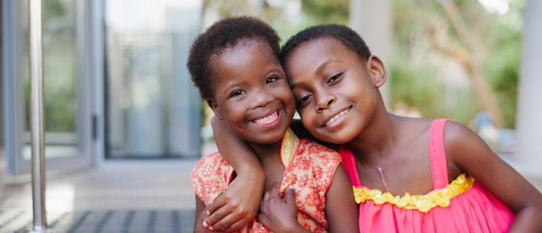 Image of two young girls smiling