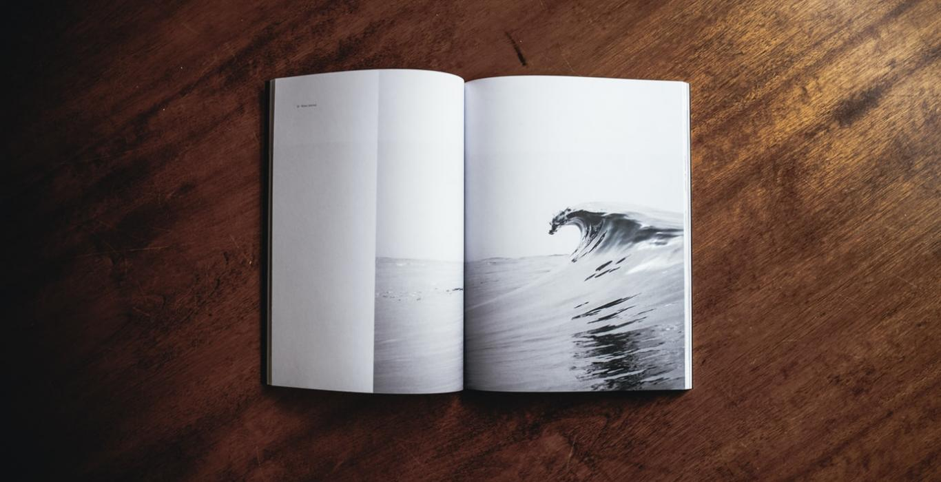 open book showing a cresting wave