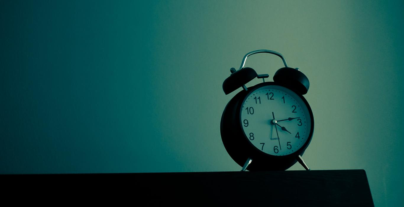 alrm clock against blue background